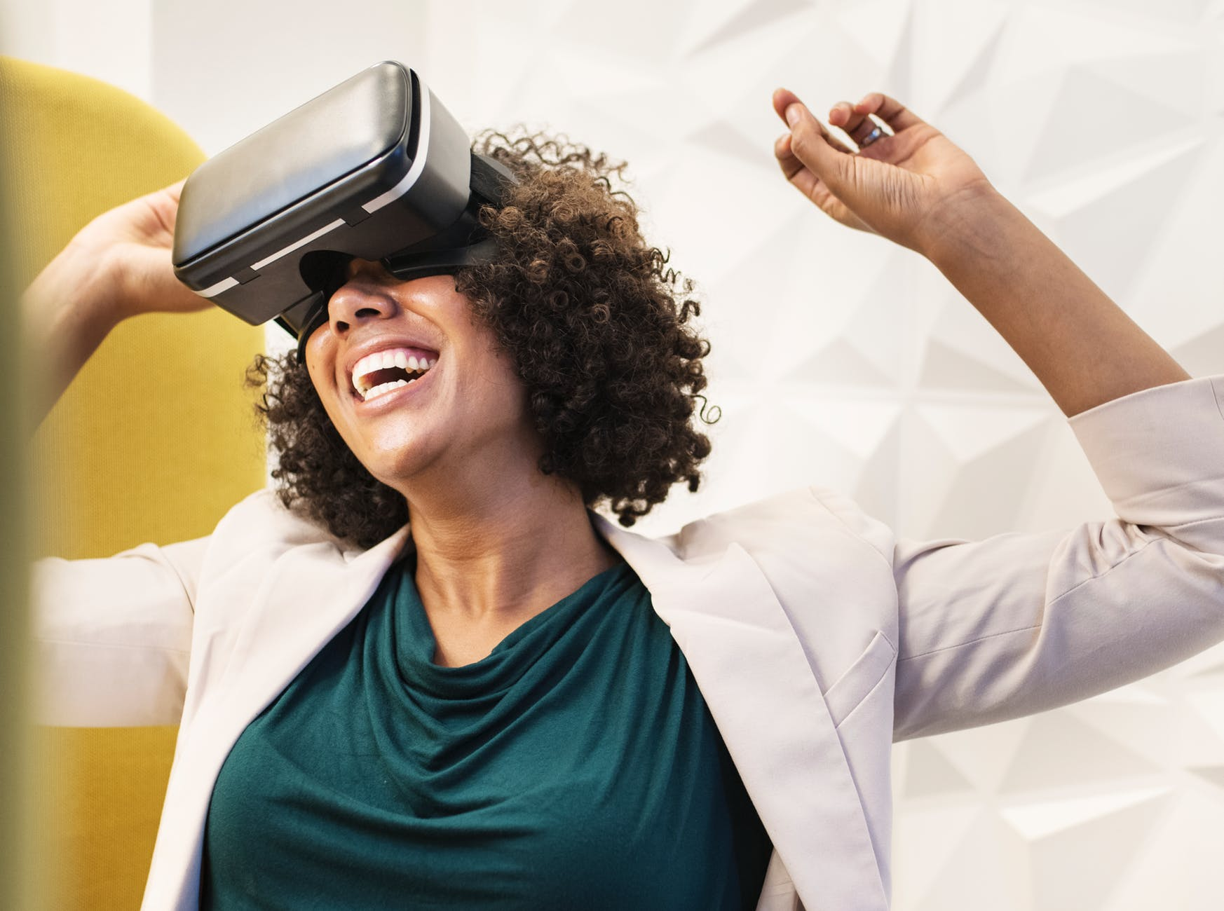 woman smiling using vr goggles